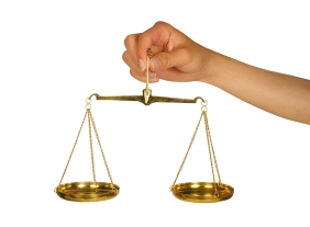 Woman holding scale of balance